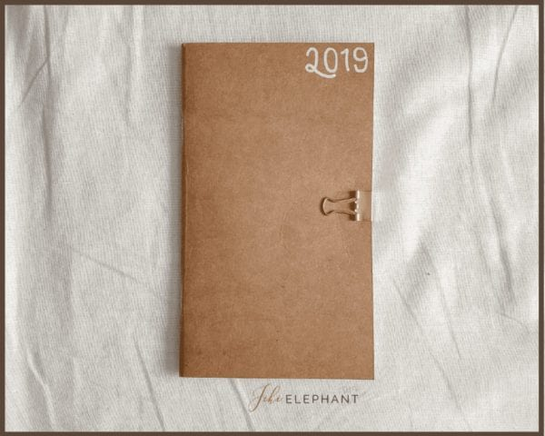 "featured image, front cover of pocket planner. Brown paper ""2019"" in white top righthand corner"