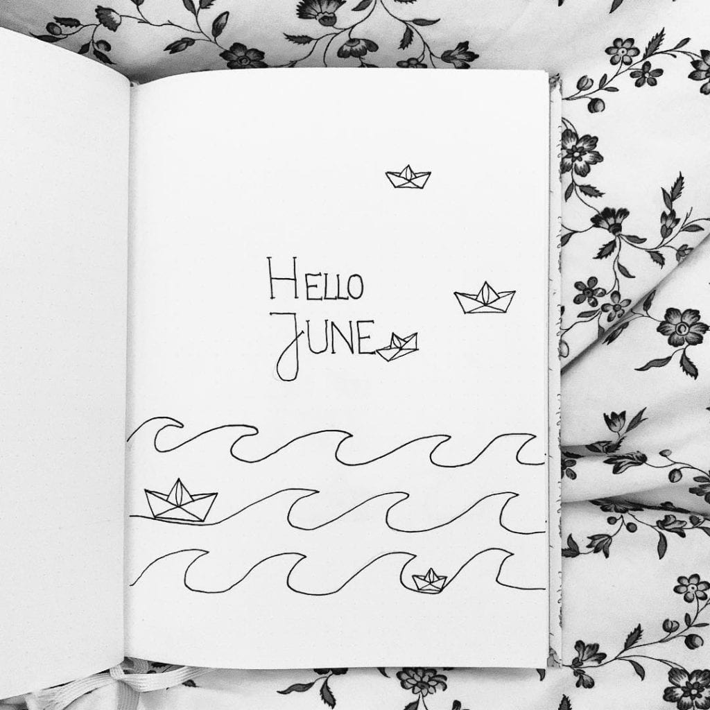 black and white hello june cover page featuring line waves art with paper boats in the waves