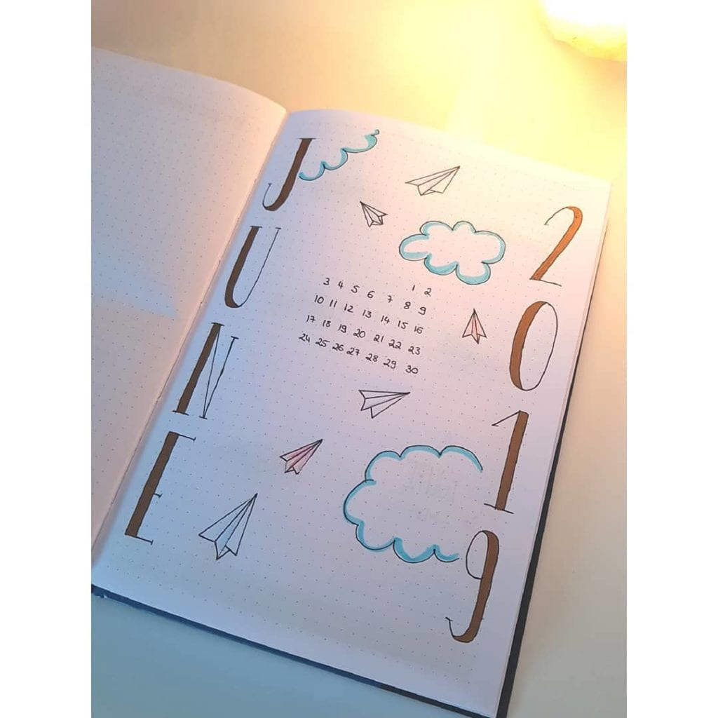 june cover page header june 2019 with clouds, paper airplanes and mini calendar