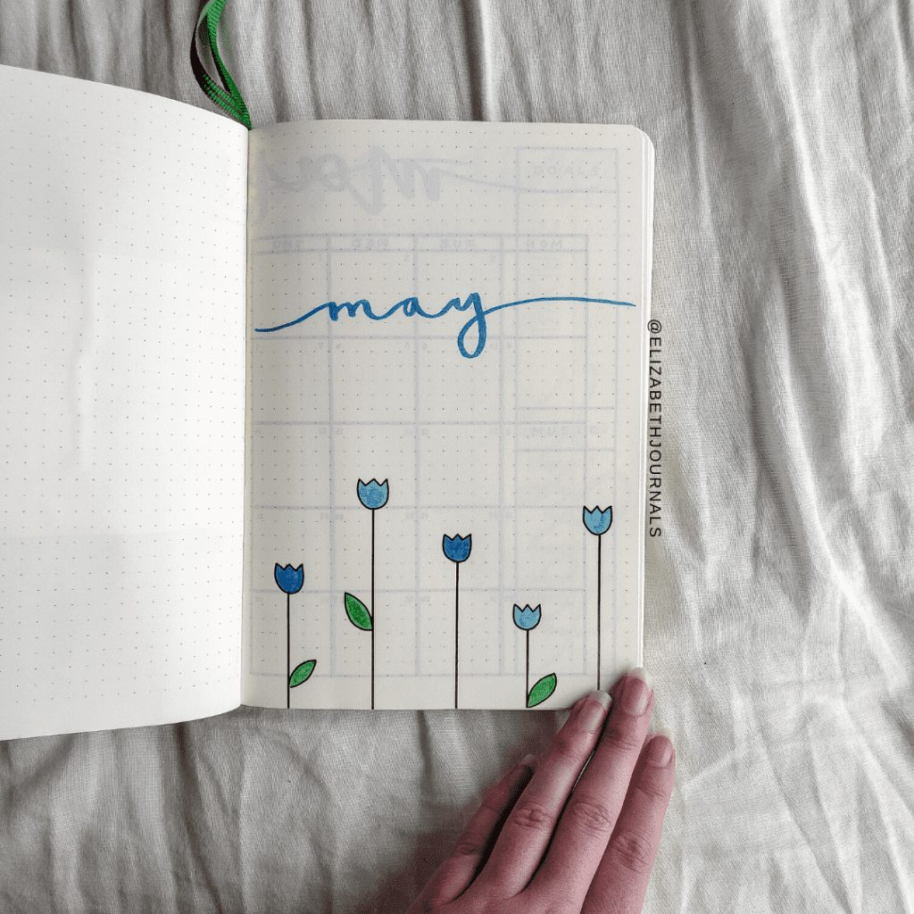 For Amanda's custom bullet journal, the primary colors used are green and blue. Further, the layouts involved include a title page, lunar calendar, future log, books to read, movies to watch, hello monthly, habits tracker, spending log, quotes, monthly mood tracker, weekly rows, monthly reflections, and a Christmas gift tracker. Here you can read more about Amanda's planner.