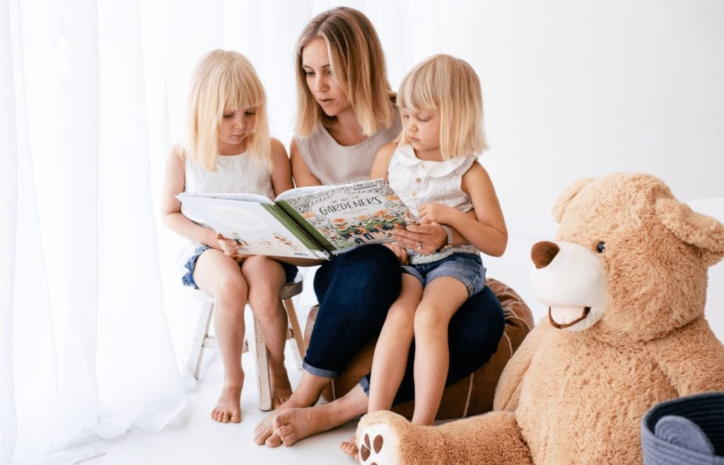 mom reading to her children