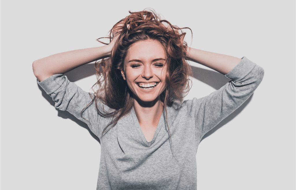 happy white female in gray shirt