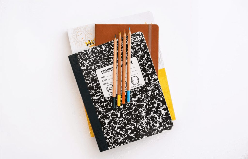 stack of notebooks with pencils on top