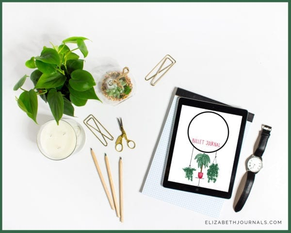 Houseplant-cover-mockup2_ flatlay with tablet showing product, watch, paper clips, scissors, plant, candle, pencils