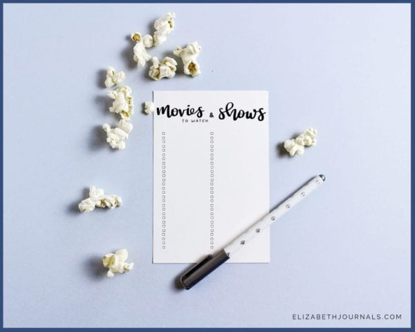 movies and tv shows to watch list-elizabethjournals-product mockup-paper with pen popcorn on light blue background