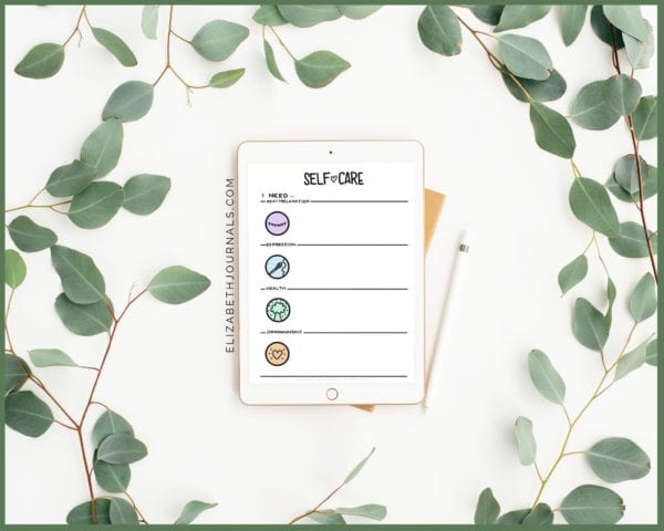 tablet showing off self-care menu surrounded by eucalyptus branches