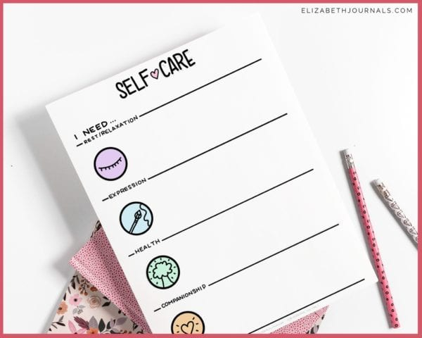 self-care menu mockup on paper with pink notebooks and pencils behind