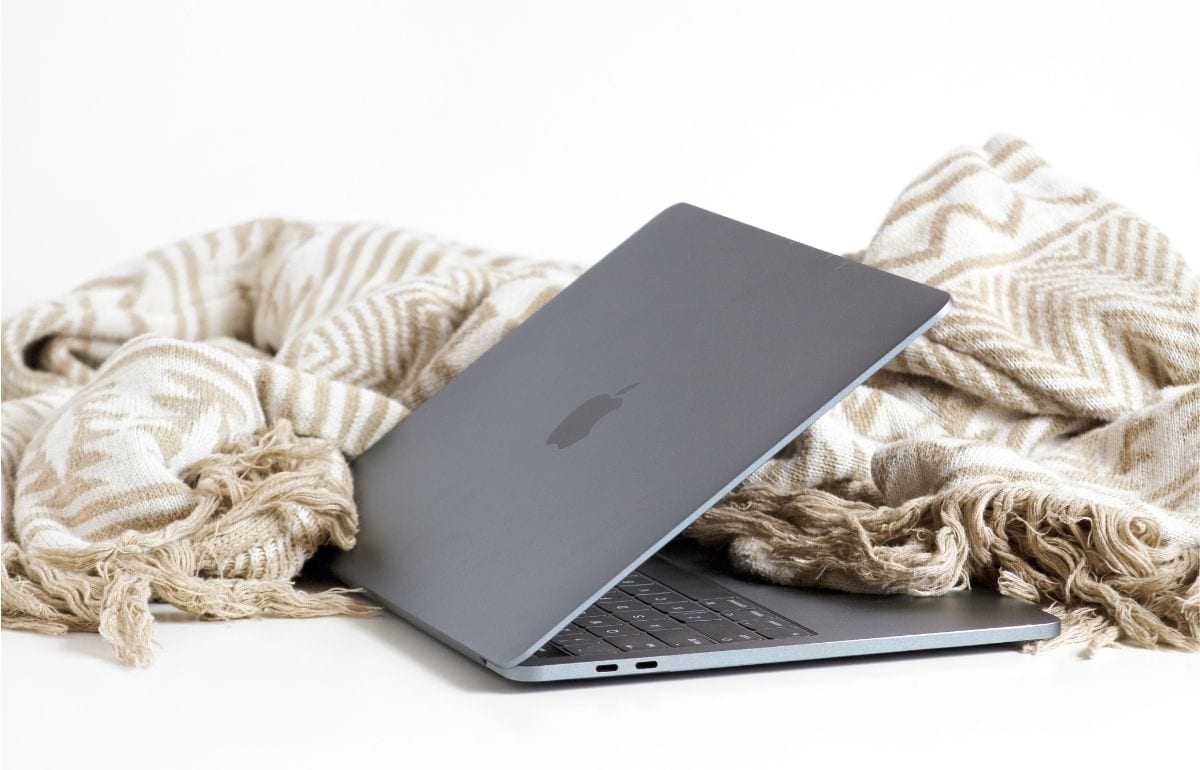 laptop and sand colored blanket