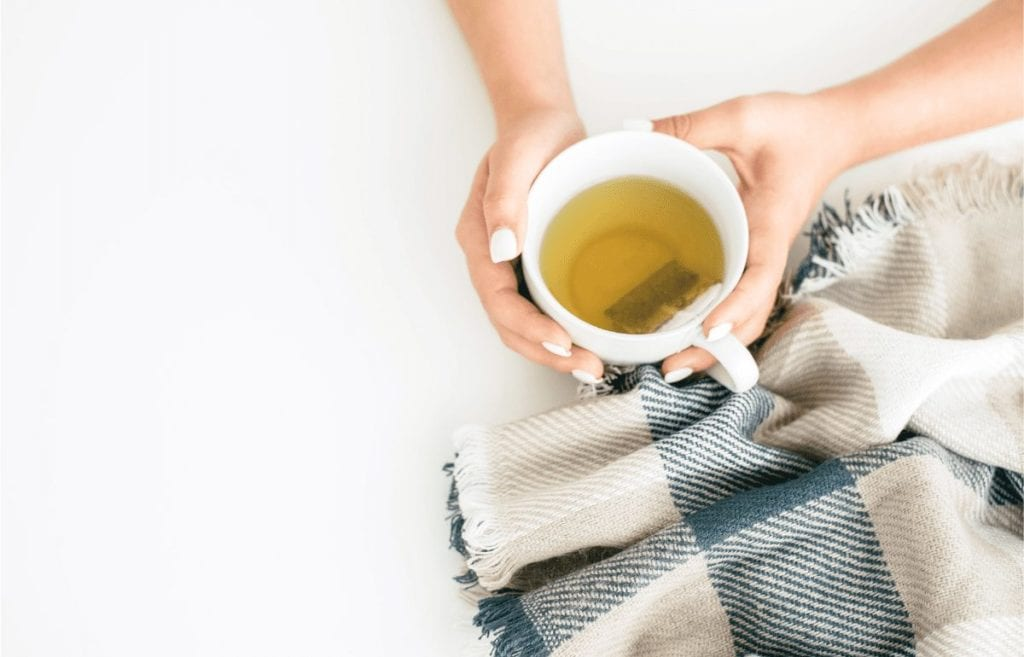 featured image cup of tea and blue and tan blanket