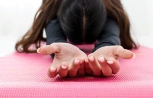 Featured-Image_woman in yoga pose close up on her hands