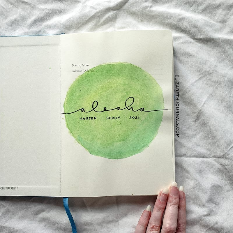 green watercolor cover page-alesha-2021 bullet journal-on white sheet