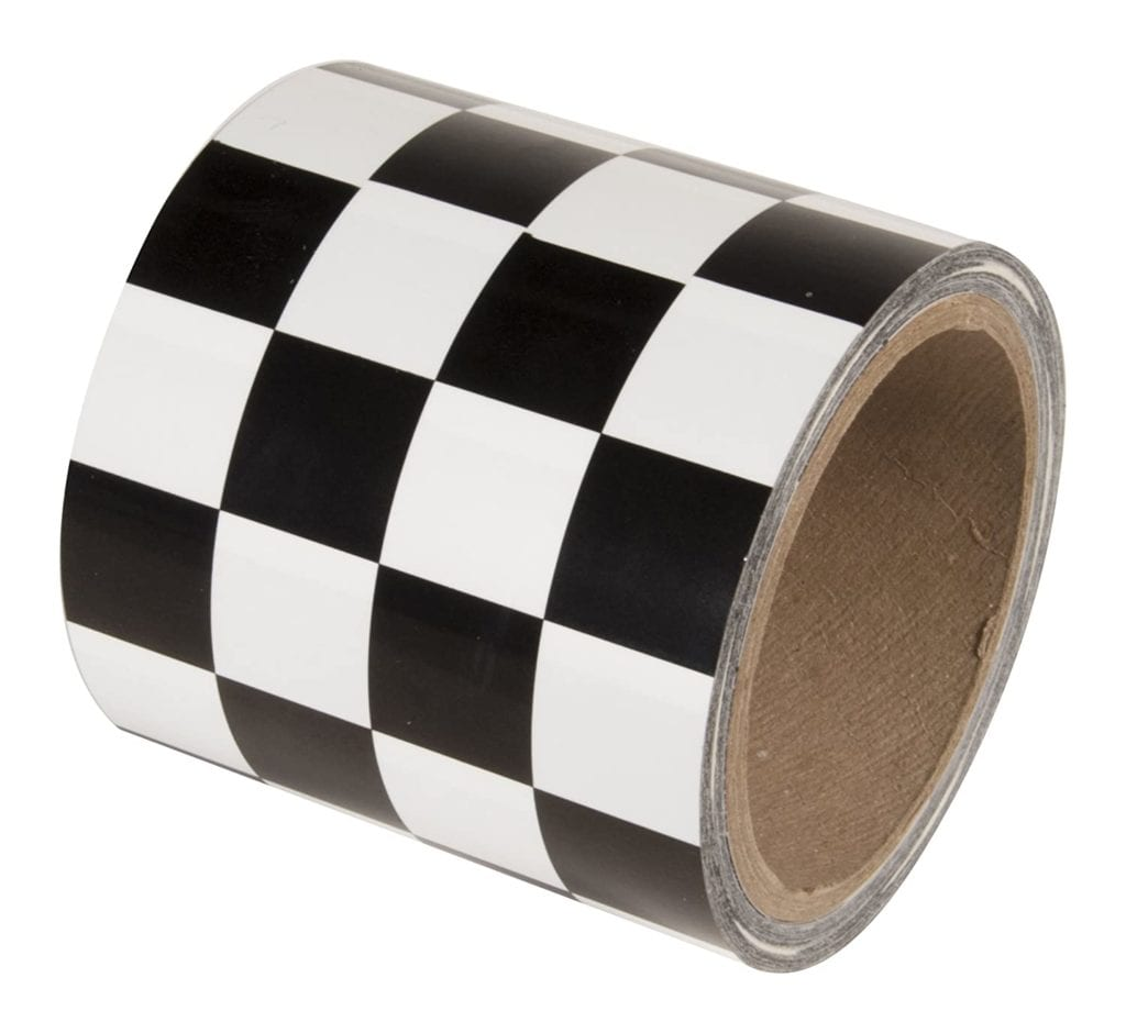 A close up of a checkerboard pattern role of washi tape