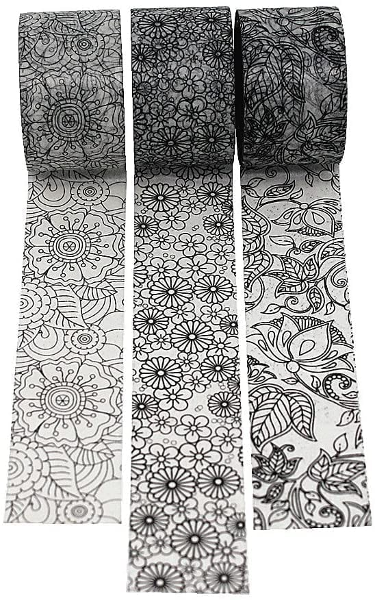 3 partially unrolled black and white washi tapes with varied floral patterns