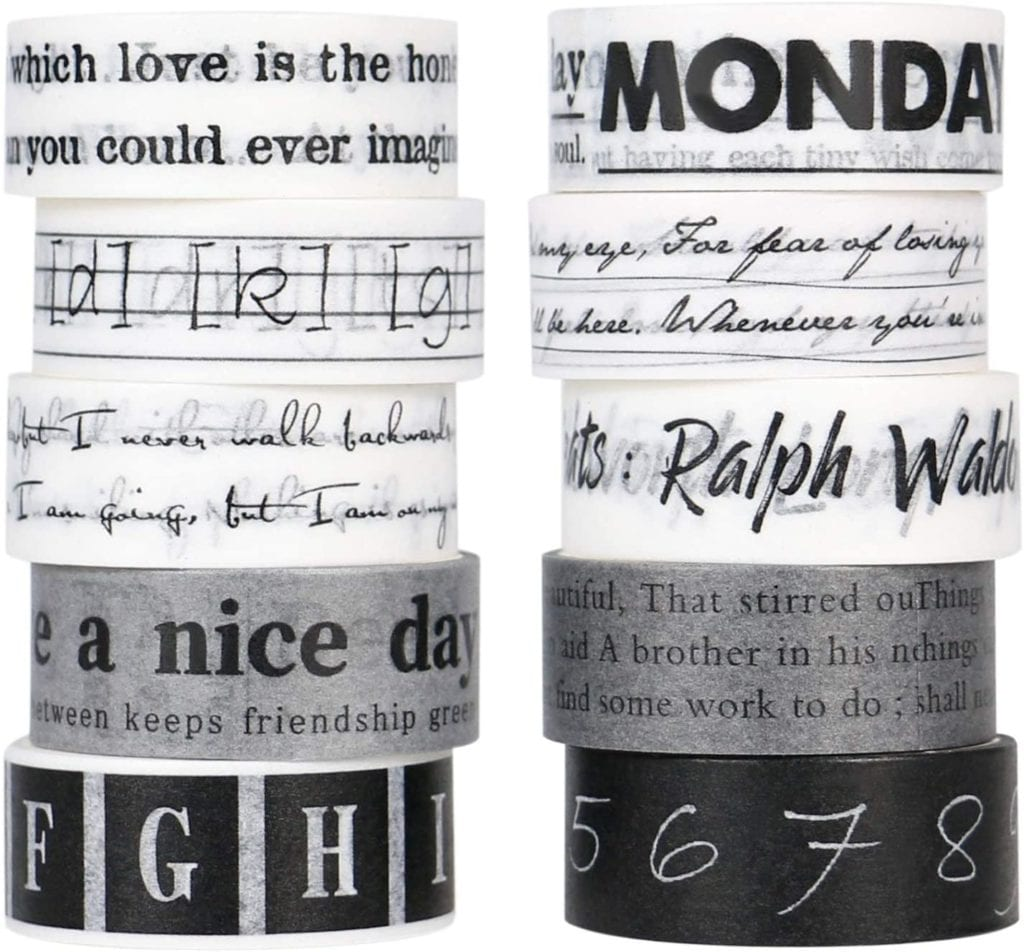 two stacks of 5 black and white washi tape with phrases, letters, words, and numbers in black and white