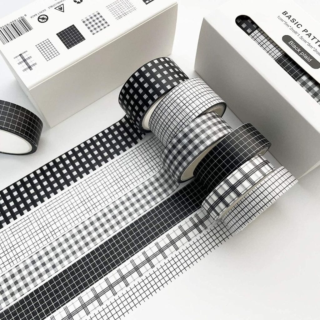 6 partially unrolled grid patterned black and white washi tape