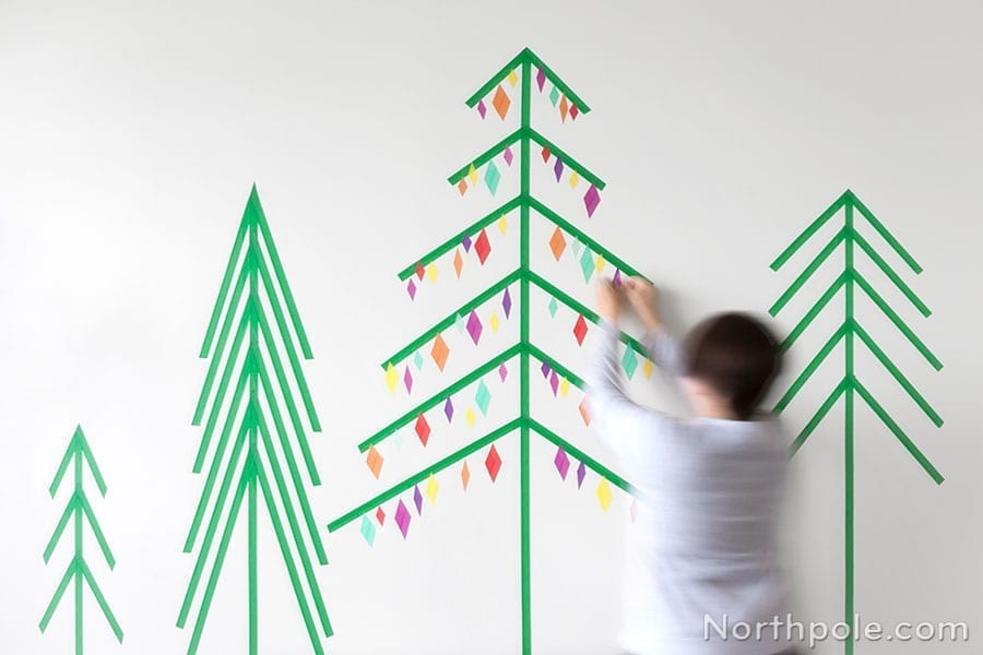 green trees and christmas trees on wall of washi tape