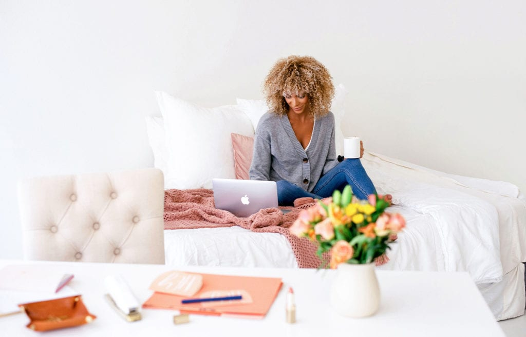 A woman sitting on a bed