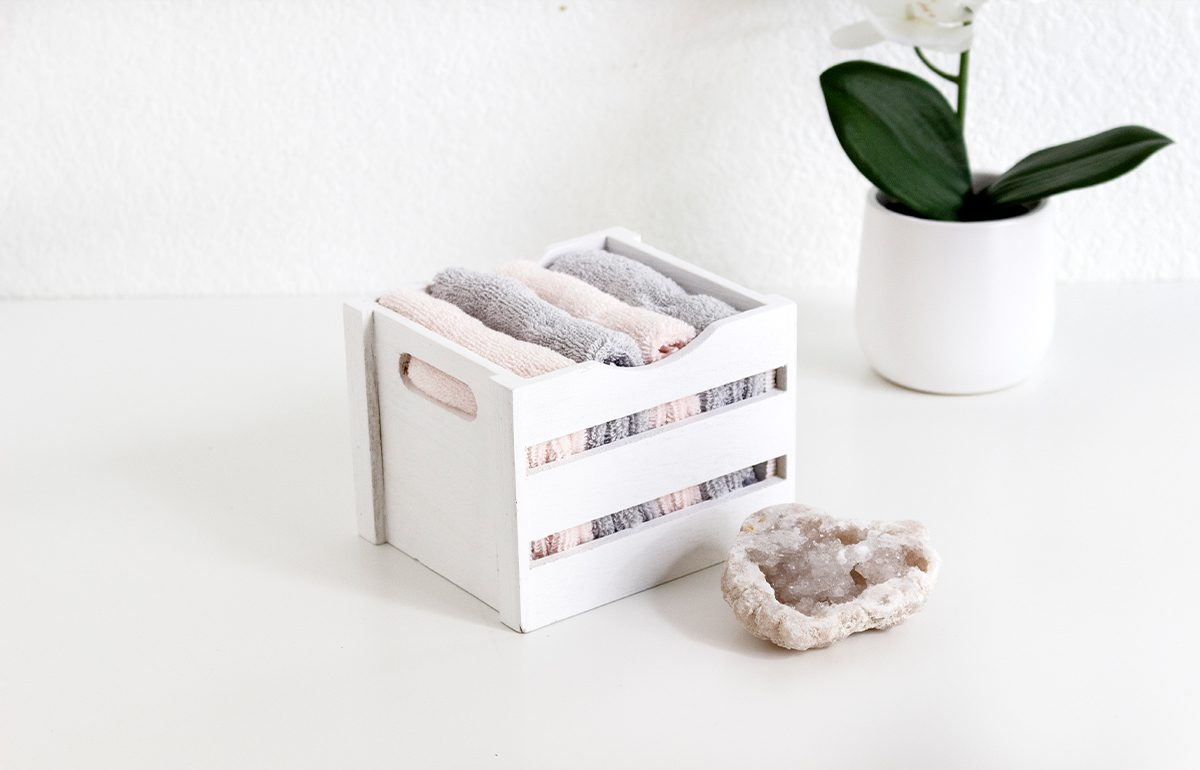 Featured-Image-organization box with towels on white surface with crystal and floral