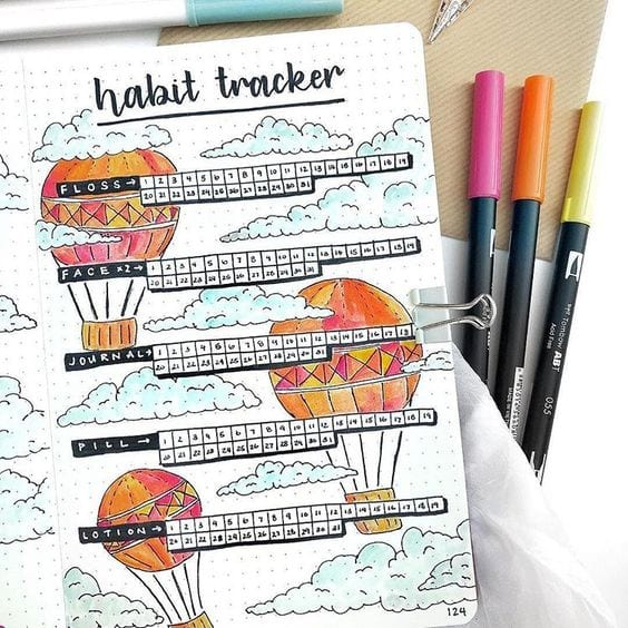 orange and red habit tracker with hot air balloons