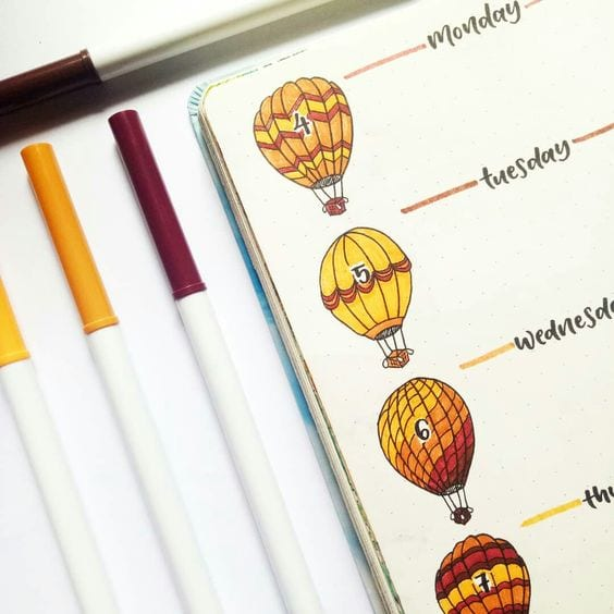 orange and yellow hot air balloons for each day weekly log