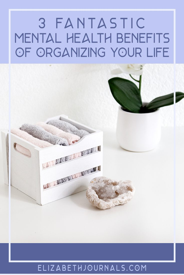 pinterest image-3 fantastic mental health benefits of organizing your life-image of towels organized in box on surface with flower pot and crystal