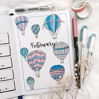 blue and pink hot air balloon february cover page bullet journal