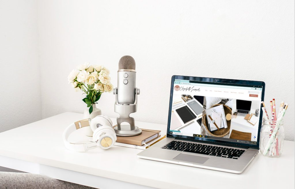 featured image_productivity podcasts_desktop with laptop open to elizabethjournals homepage and podcast recording equiptment